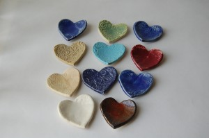 small heart rests many glaze colors