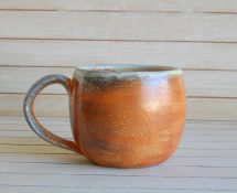 Hand made ceramic mug with orange slip, hand made