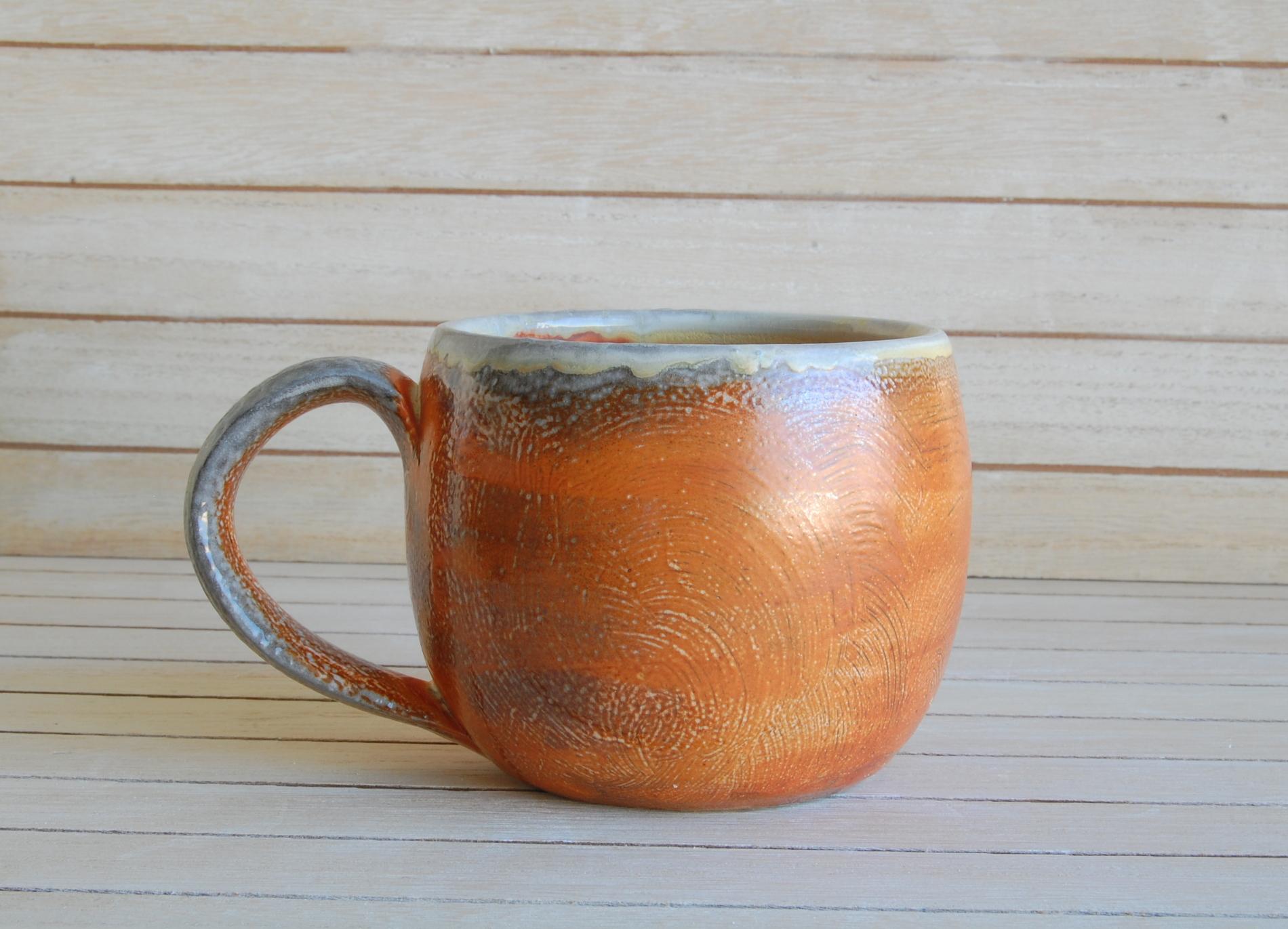 Hand made ceramic mug with orange slip, hand made