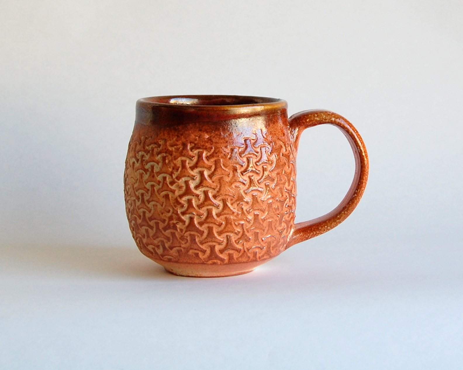 Orange and brown textured ceramic mug, hand made