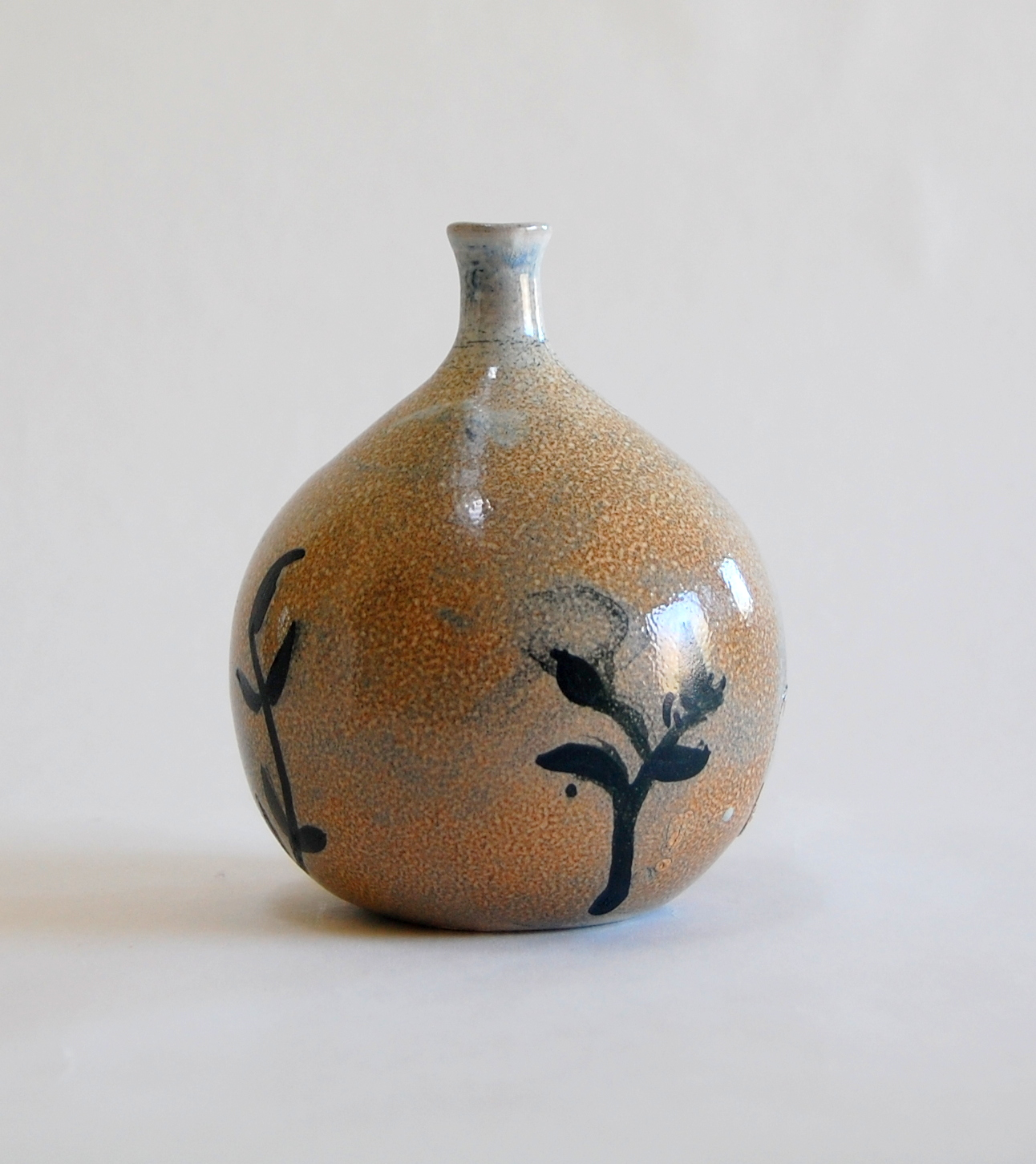 Hand made Soda fired round bottle with inky leaf design