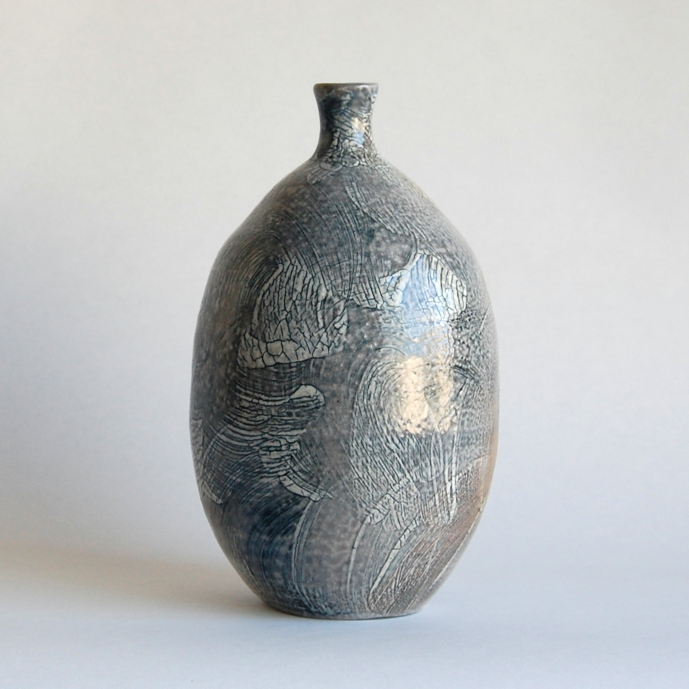 Tall 6.5 inch blue and white, hand made, soda fired bottle with slip design