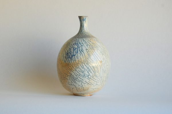 Wheel thrown Soda Fired Bottle with stormy blue crackle and beige flashing
