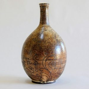 Etched brown clay bottle handmade by Gabrielle Koza